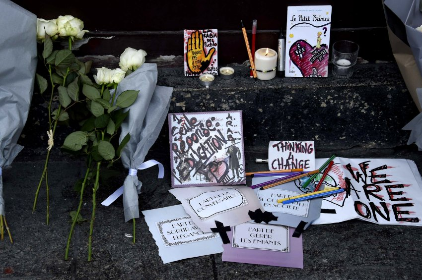 "Tributes to victims of the attacks lie near the entrance to the Carillon restaurant in Paris on November 14, 2015 following a series of coordinated attacks in and around Paris late Friday which left more than 120 people dead. French President Francois Hollande blamed the Islamic State group for the attacks in Paris that left at least 128 dead, calling them an ""act of war"". The multiple attacks across the city late Friday were ""an act of war... committed by a terrorist army, the Islamic State, against France, against... what we are, a free country,"" Hollande said. AFP PHOTO / DOMINIQUE FAGET"